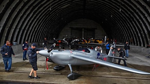Technical Manager Wade Hammond of South Africa pulls out the airplane of Hannes Arch of Austria from the hangar during the fourth stage of the Red Bull Air Race World Championship in Tokol, Hungary on July 17, 2016.